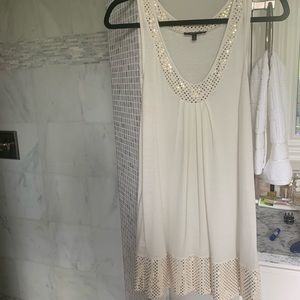 Express dress cream with gold sequins